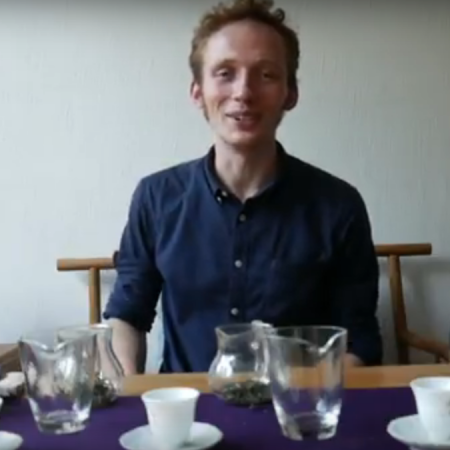Dylan Conroy sits at a chinese gong fu cha tea table